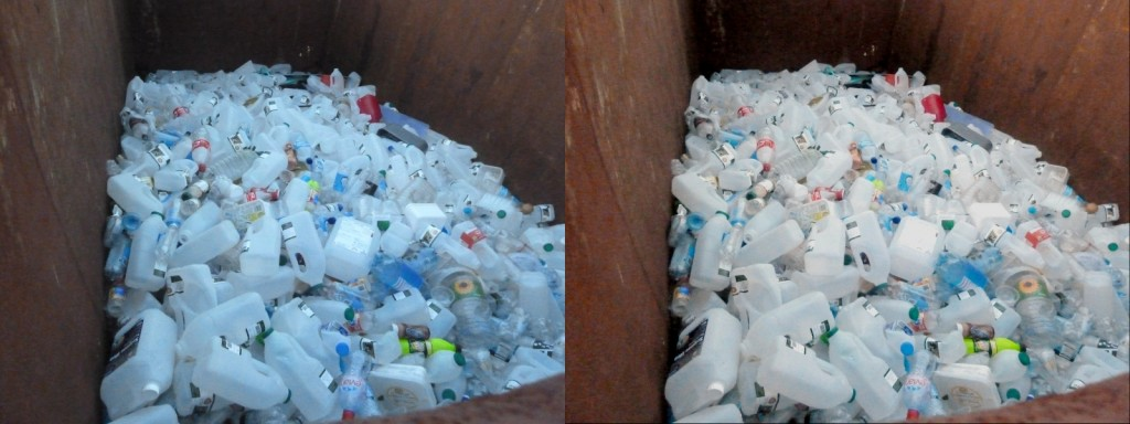 A large pile of empty plastic milk containers, two version with different colours