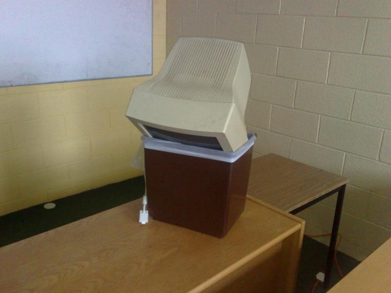 A computer monitor in a bin